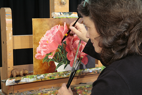 Photograph of Ann Trusty Painting a Floral in Oil