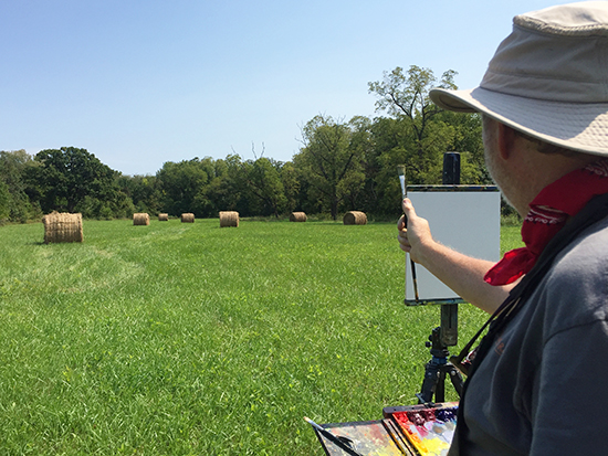 John Hulsey plein air painting in a field