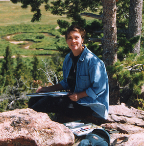 Photograph of Ann Trusty painting in Rocky Mountain National Park